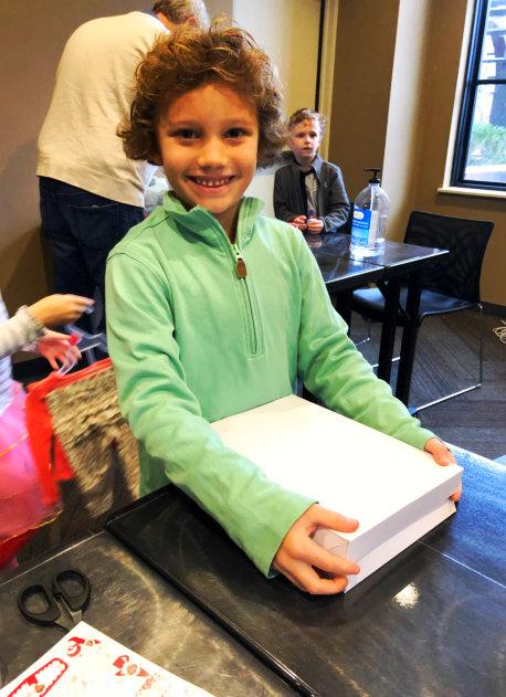 kid wearing jacket and smiling